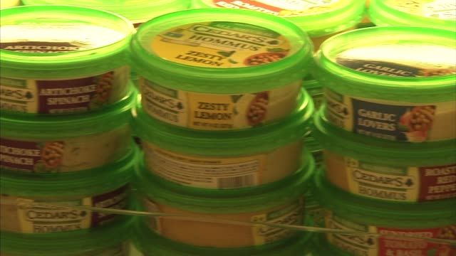 close up shots of various flavors of cedars brand hummus on display in a supermarket refrigerator aisle in new york ny - kieferngewächse stock-videos und b-roll-filmmaterial