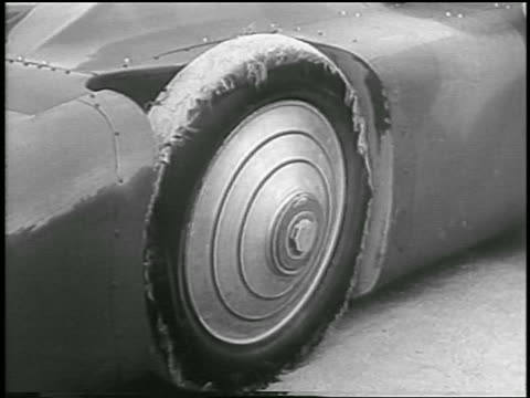 b/w 1935 close up shredded tire on experimental race car / daytona beach - 1935 stock videos & royalty-free footage