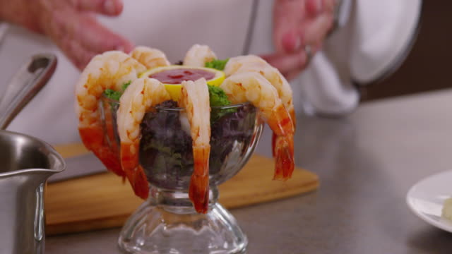 close up shrimp cocktail, camera pans to plate with steak fillet and mashed potatoes. - マッシュポテト点の映像素材/bロール