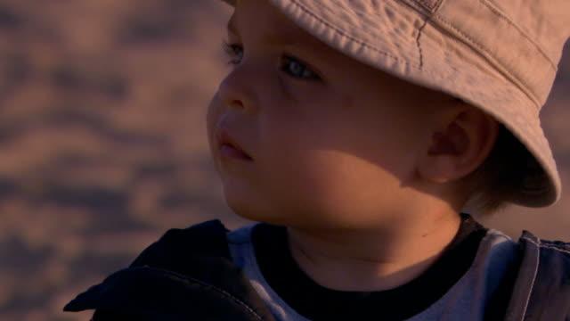 vídeos de stock, filmes e b-roll de close up side view of toddler boy at the beach - 2004