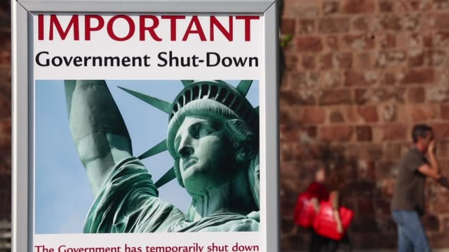 "close up, sign featuring the statue of liberty and reading: ""important government shut-down"". - government shutdown stock videos & royalty-free footage"
