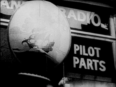 b/w 1927 close up sign for radio pilot parts / newsreel - anno 1927 video stock e b–roll