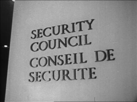 B/W 1967 close up sign for 'Security Council / Conseil de Securite' at the United Nations NYC / newsreel
