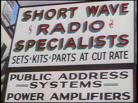 1939 close up sign for short wave radio specialists / industrial - 1939 stock-videos und b-roll-filmmaterial