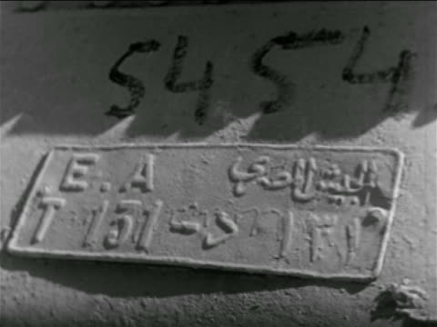 close up sign on tank with arabic writing on it / suez crisis / newsreel - 1956 stock-videos und b-roll-filmmaterial