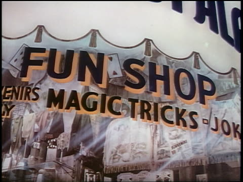 1939 close up sign on window for Fun Shop + Magic Tricks / industrial