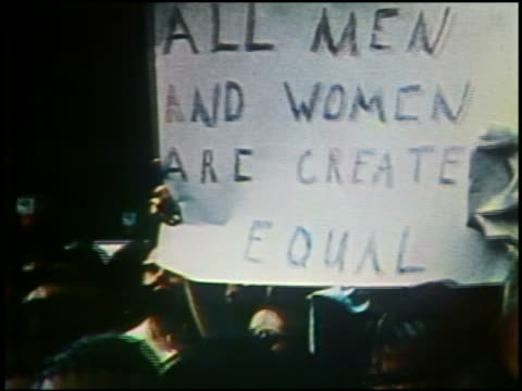 1975 close up sign reading 'All men and women are created equal' at Women's Liberation march