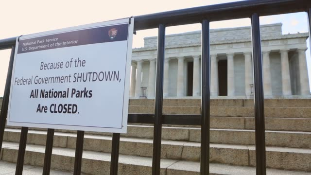 "close up, sign reading: ""because of the federal government shutdown, all national park are closed"". despite being kept about 100 meters back from the... - government shutdown stock videos & royalty-free footage"