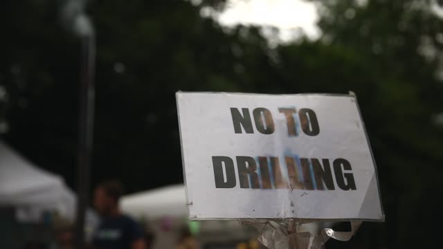 close up, sign reading no to drilling. protesters gather outside a drill site operated by cuadrilla resources ltd on august 19, 2013 in balcombe,... - west sussex stock videos & royalty-free footage