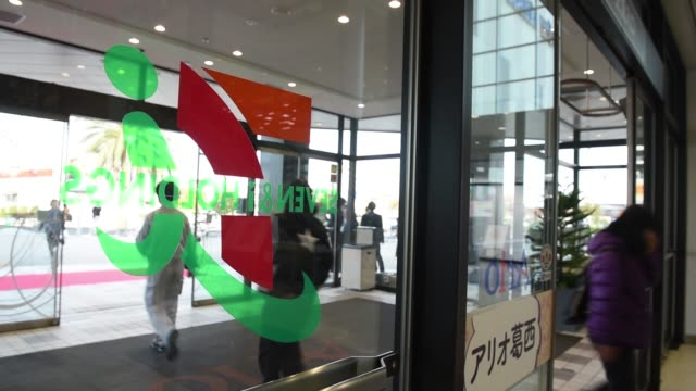 Close up signage for Ario and Seven i Holdings is displayed atop the Ito Yokado Co Ario shopping center owned by Seven i Holdings Co during its...