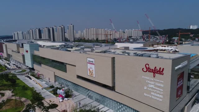 close up signage for starfield goyang shopping complex operated by shinsegae property inc is seen in this aerial video taken above goyang south korea... - goyang stock videos and b-roll footage