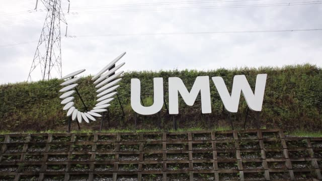 Close up signage for UMW Holdings Bhd stand outside the UMW Aerospace Sdn manufacturing facility in Serendah Selangor Malaysia on Wednesday Nov 29...
