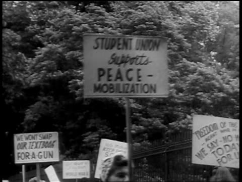 b/w 1939 close up signs of student protesters marching in front of white house / newsreel - peace demonstration stock videos and b-roll footage
