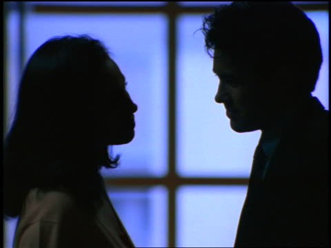 close up silhouette couple kissing shyly - flirtare video stock e b–roll