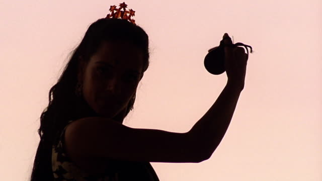 close up silhouette woman dancing flamenco with castanets / parc guell, barcelona, spain - flamenco dancing stock videos and b-roll footage