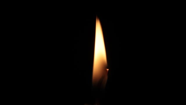 close up single candle flame - flame stock videos & royalty-free footage