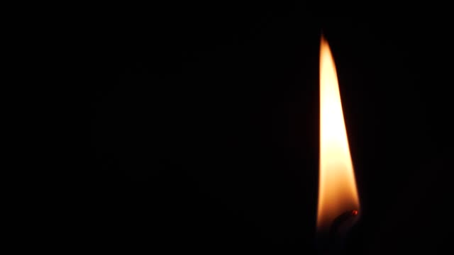 close up single candle flame - match lighting equipment stock videos & royalty-free footage