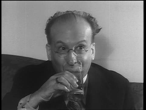 b/w 1933 close up sitting man with eyeglasses drinking from glass / end of prohibition - 1933 stock videos & royalty-free footage