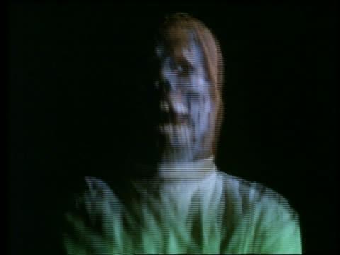 close up skeletal monster in green shirt / black background - horror movie stock-videos und b-roll-filmmaterial