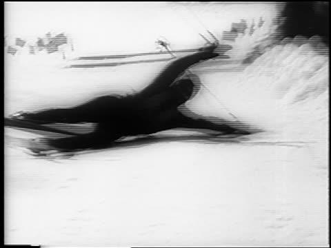 b/w 1961 close up skier wiping out towards camera at german alpine championships in garmisch / newsreel - falla av bildbanksvideor och videomaterial från bakom kulisserna