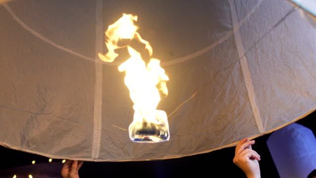 close up sky lantern loi krathong traditional festival - november stock videos & royalty-free footage