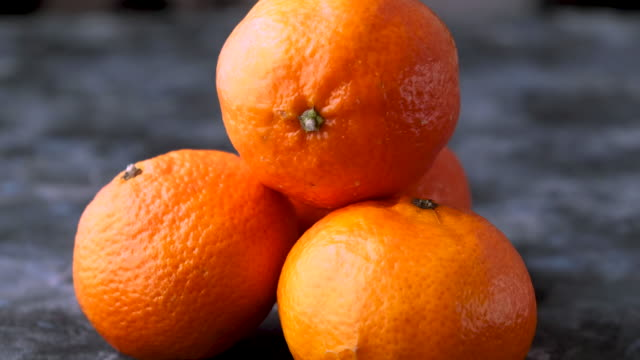 close up sliding- spinning shot of fresh tangerines - orange stock videos & royalty-free footage