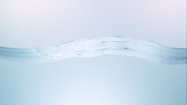 stockvideo's en b-roll-footage met close up slow motion of a calm water surface from a lower angle - drinkwater