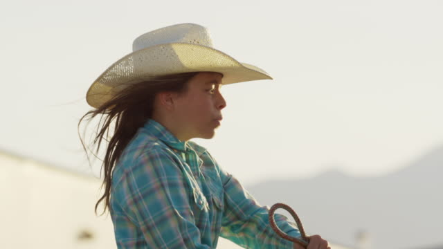 close up slow motion panning shot of girl riding horse / lehi, utah, united states - lehi stock videos & royalty-free footage