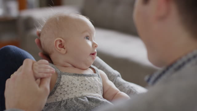 close up slow motion shot of father playing with baby daughter / provo, utah, united states - provo stock videos & royalty-free footage