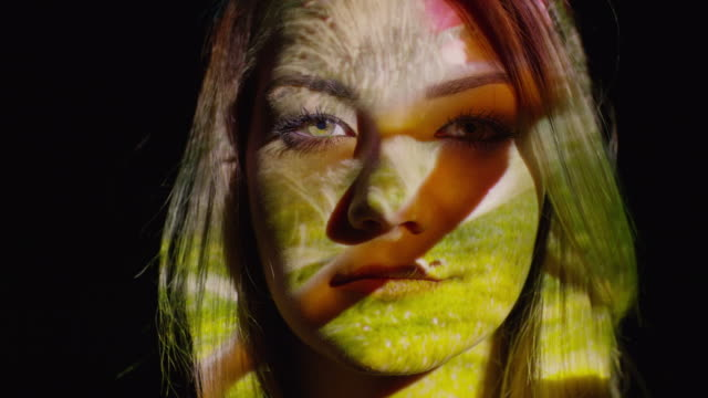 """""""close up slow motion shot of projections on woman‰ûªs face / cedar hills, utah, united states"""" - projektion stock-videos und b-roll-filmmaterial"""