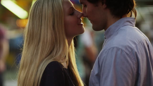 Close up, Slow Motion shot of young couple kissing / American Fork, Utah, United States