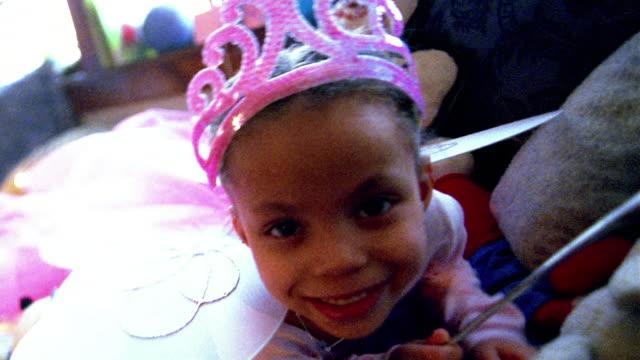 close up small black girl in costume posing - ドール点の映像素材/bロール