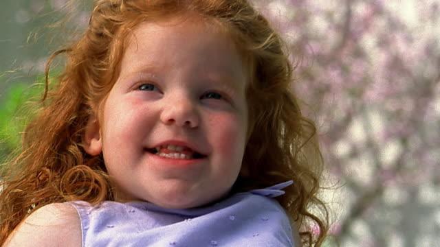 Close up small redhead girl