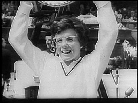 close up smiling billie jean king holding up trophy after winning wimbledon / england / newsreel - only women stock videos & royalty-free footage