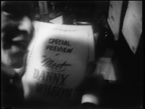b/w 1951 close up smiling frank sinatra holding flyer for preview of meet danny wilson / newsreel - 1951 stock videos & royalty-free footage