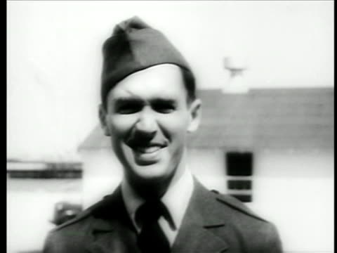 b/w 1942 close up smiling lt james stewart in air force uniform saluting to cam after promotion / doc - solo uomini di età media video stock e b–roll