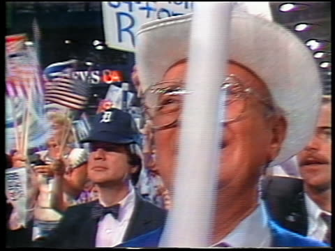 1984 close up smiling man in eyeglasses cowboy hat in crowd at Republican National Convention / Dallas