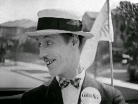b/w 1927 close up smiling man in hat with mustache driving convertible on street / feature - nur männer über 30 stock-videos und b-roll-filmmaterial