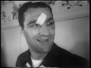 vidéos et rushes de close up smiling rocky marciano with bandage on forehead + top of head / after walcott fight - 1952