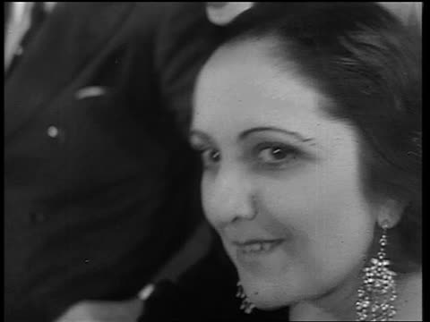 close up smiling woman with large earrings leaning forward / end of prohibition - 1933 stock videos & royalty-free footage