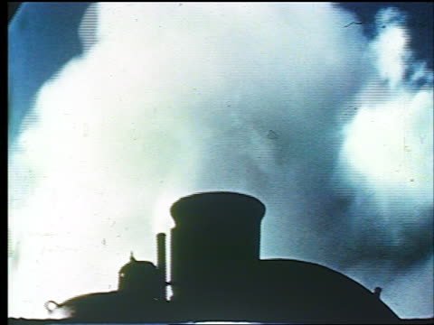 vídeos de stock, filmes e b-roll de 1947 close up smoke coming from smokestack of steam train moving slowly / educational - lugar genérico