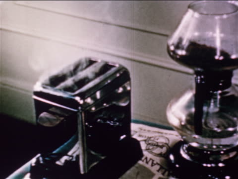 1950 close up smoke coming out of toaster on table / educational - toaster appliance stock videos & royalty-free footage