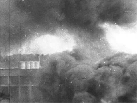 b/w 1967 close up smoke flames after bombing in six day war / jerusalem / newsreel - 第三次中東戦争点の映像素材/bロール