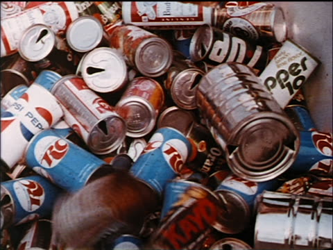 1972 close up soda cans being thrown into recycling pile / industrial - 1972 stock videos & royalty-free footage