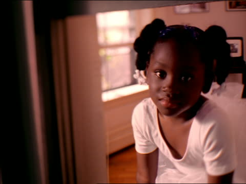 close up soft focus portrait black girl in tutu leaning out open window - ballet dancer stock videos & royalty-free footage