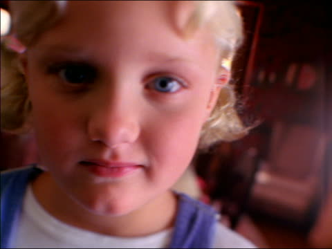 canted close up soft focus portrait young blond girl indoors - weichzeichner stock-videos und b-roll-filmmaterial