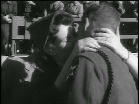 b/w 1954 close up soldier returning from korean war kissing woman outdoors / seattle / newsreel - 1954 stock videos & royalty-free footage