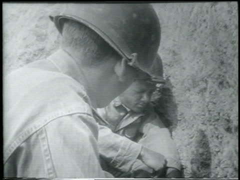 b/w 1952 close up soldiers shielding eyes from hydrogen bomb explosion / yucca flats nevada / newsreel - hydrogen bomb stock videos and b-roll footage