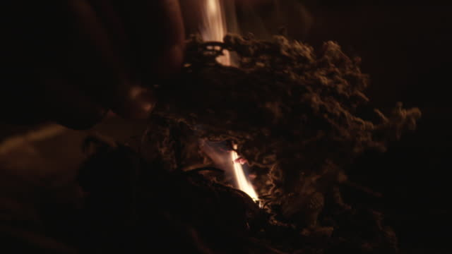 close up, south african witch doctor burns herbs in slow motion - witch stock videos & royalty-free footage