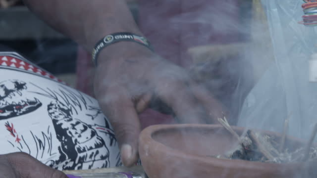 stockvideo's en b-roll-footage met close up, south african witch doctor burns herbs - ceremonie